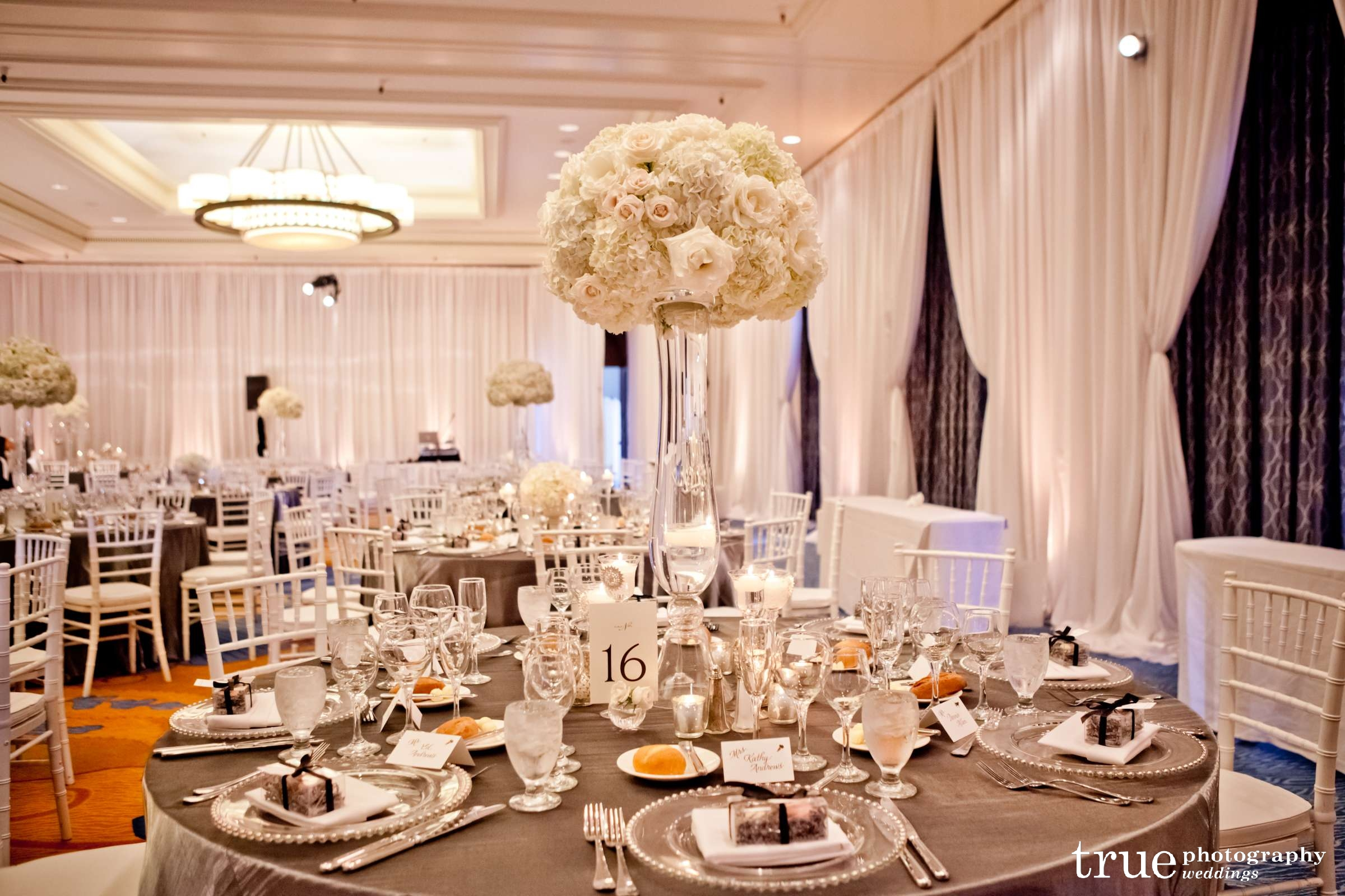 White centerpieces blush botanicals san diego florist for Tall candle centerpieces